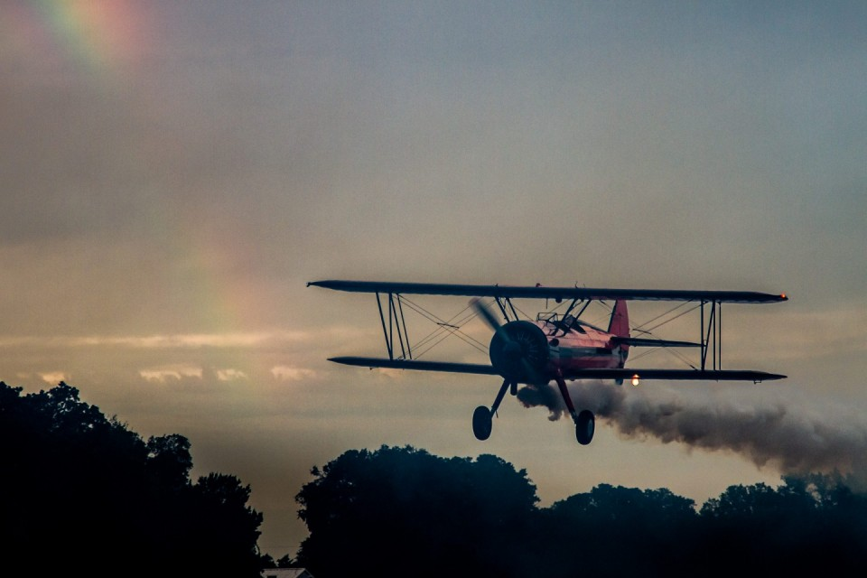 Red Biplane with Rainbow in Background