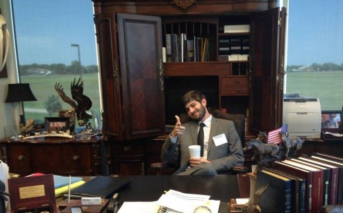 Hank Sasser in office with thumbs up