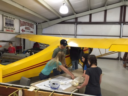 Candler Field Museum and Youth Mentorship Program Students Building Plane